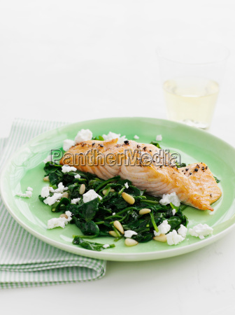 plate of salmon with spinach