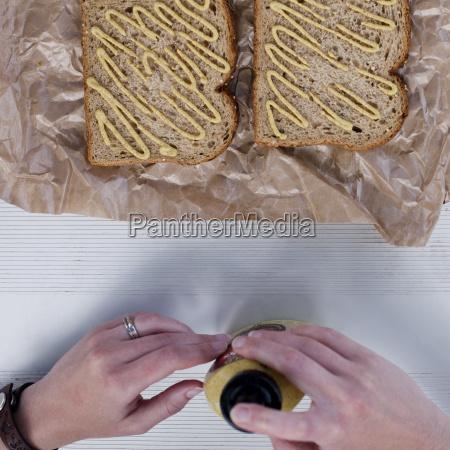 woman making sandwich overhead view