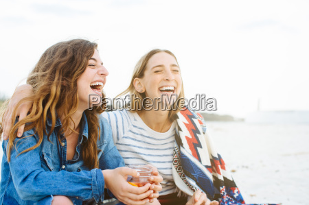 two young female friends laughing on