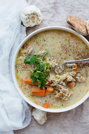 bowl of stew with herbs and