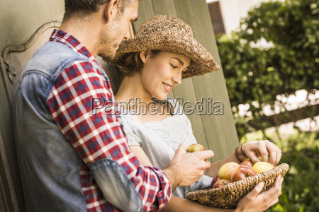 couple leaning against shed young woman