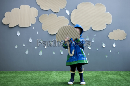 baby girl with umbrella and rain