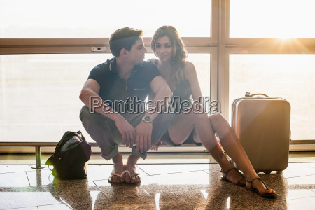 young couple sitting on railing in