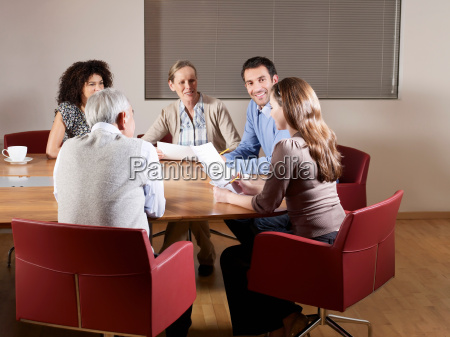group of people at boardroom table
