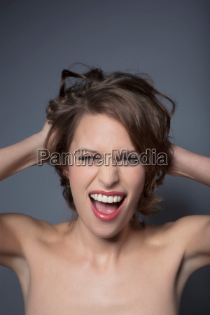 close up of womans laughing face