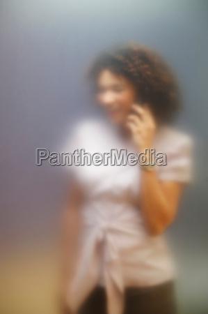 woman, on, phone, behind, screen - 19501436