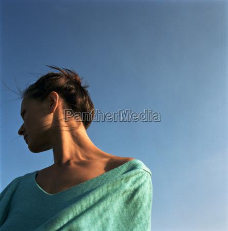 woman looking away in warm sun