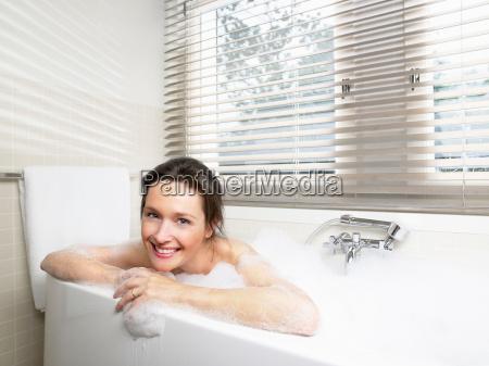 woman in bathroom taking a bath