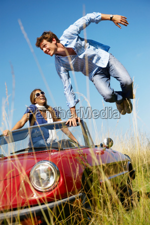 man jumping out of a car