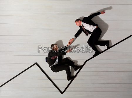 business men climbing up graph