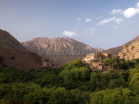 a kasbah sits in the hills