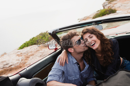 couple kissing in car