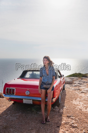 woman leaning at car