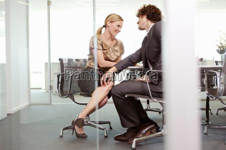 businessman and woman having meeting at