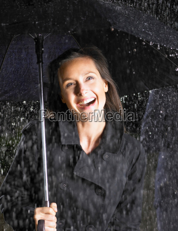 woman with umbrella smiling