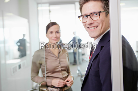 man and woman wearing business attire
