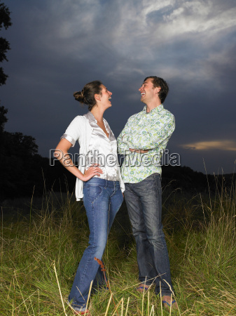 man and woman in a field