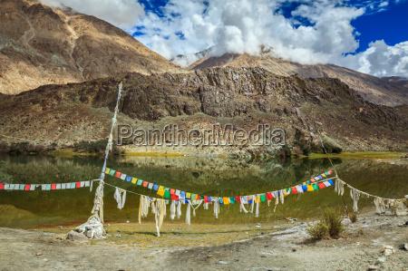 prayer flags on lohan tso lake