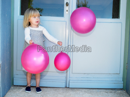 girl with pink balloons