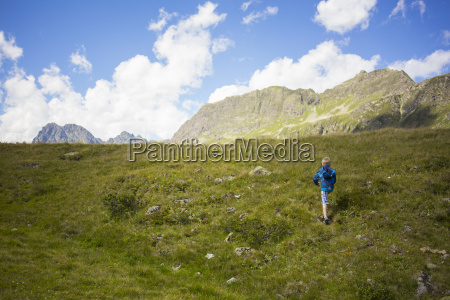 boy walking up mountainside tyrol austria
