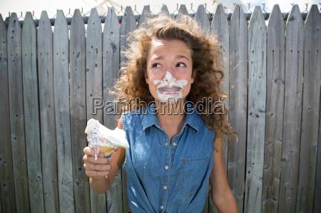 teenage girl with ice cream on
