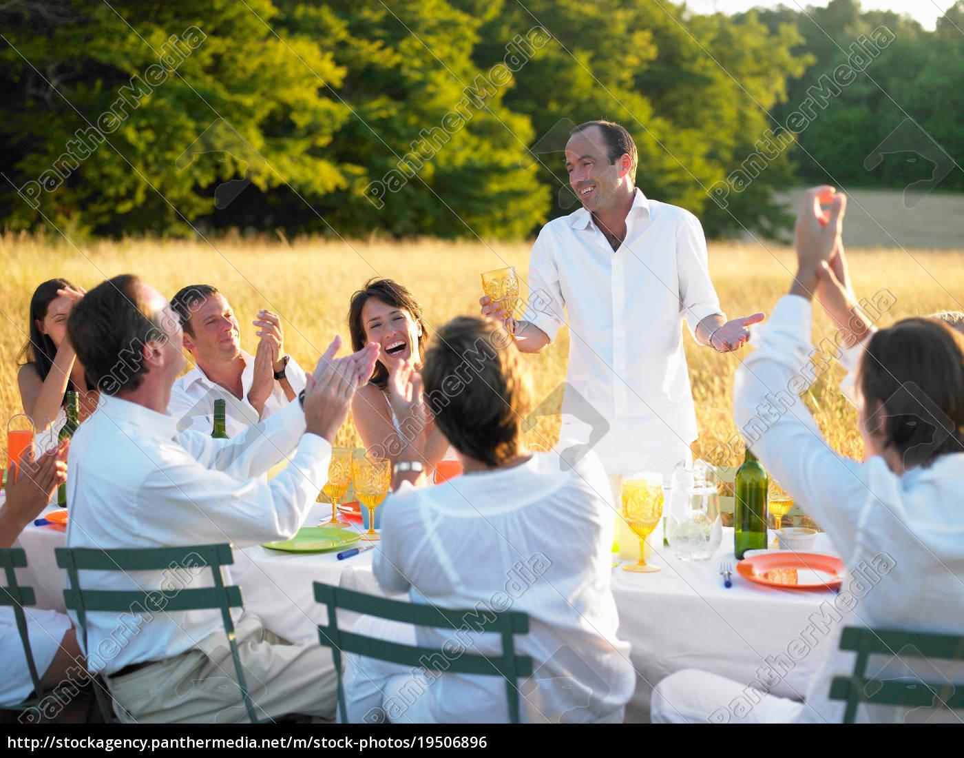 group, of, people, having, dinner, , sunset - 19506896