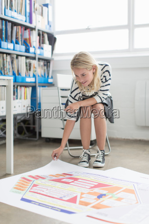 young office worker looking at plans