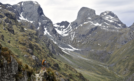 woman hiking in mountains new zealand