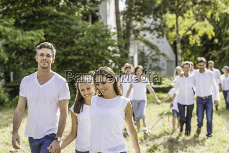 group of people walking through forest