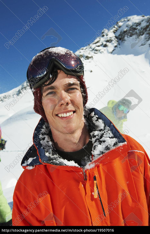 portrait, of, man, wearing, orange, ski - 19507016