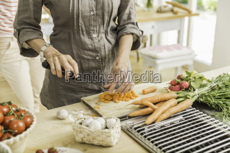 cropped shot of senior woman preparing