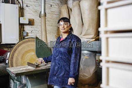 portrait of female printer using circular