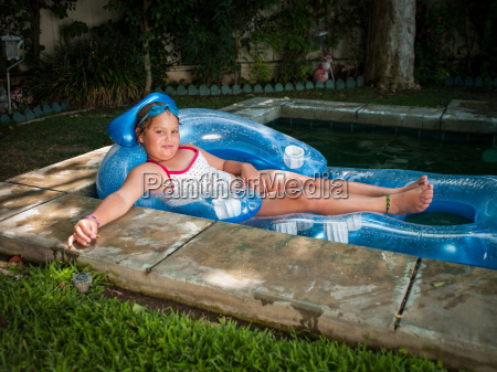 portrait of girl reclining on inflatable