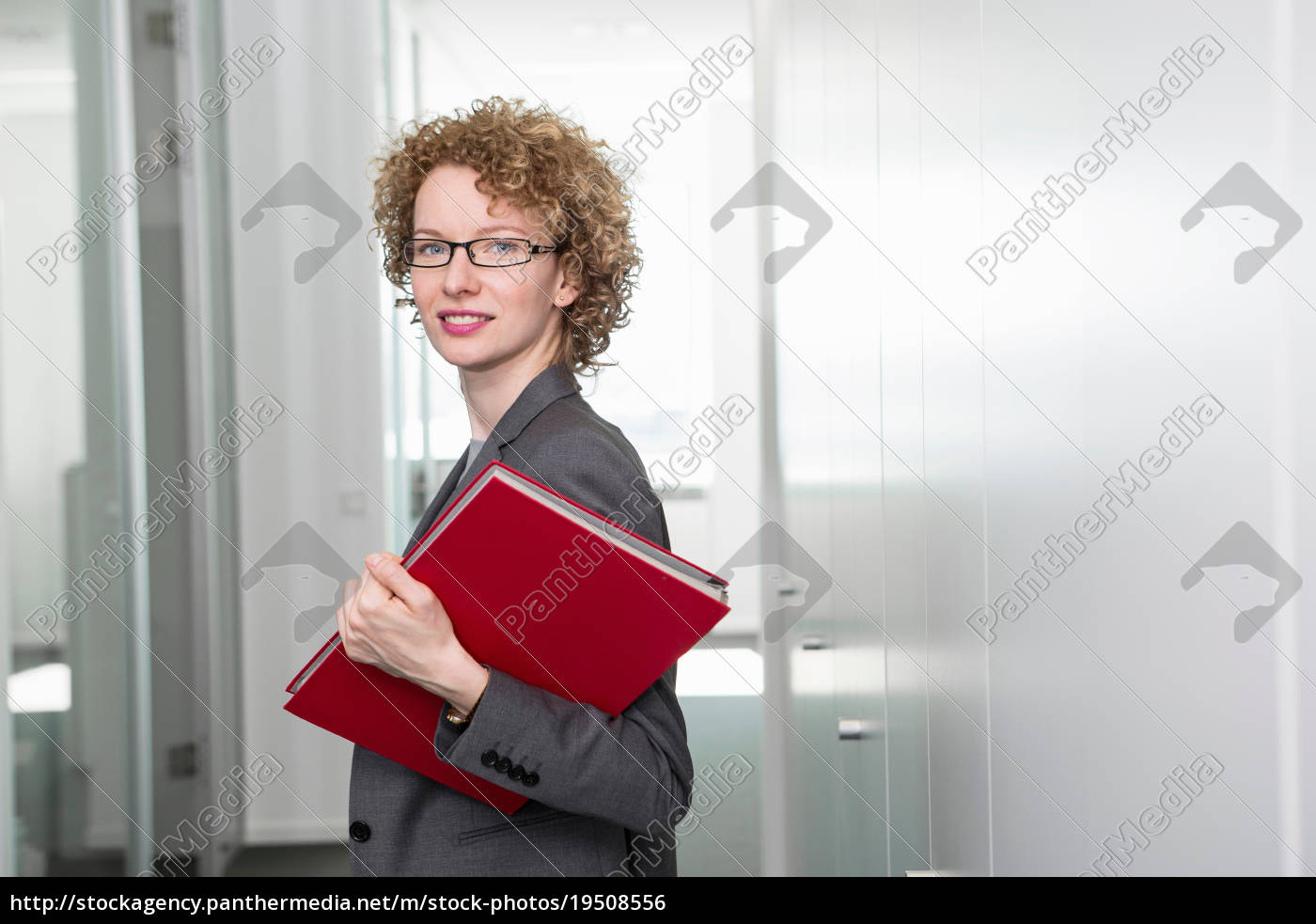 portrait, of, businesswoman, holding, red, file - 19508556