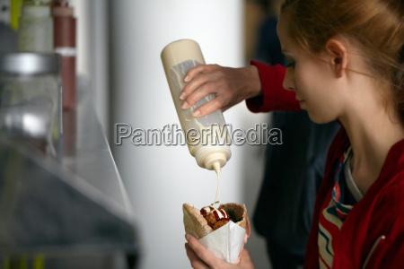 woman having food cart sandwich