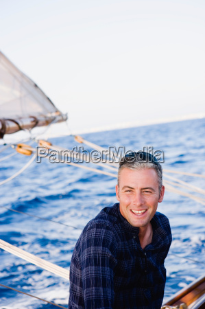 man on a sailing boat smiling