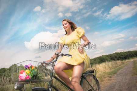 adolescent girl cycling on dirt track