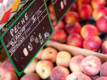 white peaches at a market in