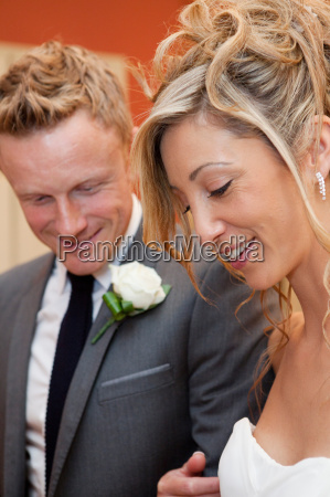 bride and groom smiling at wedding