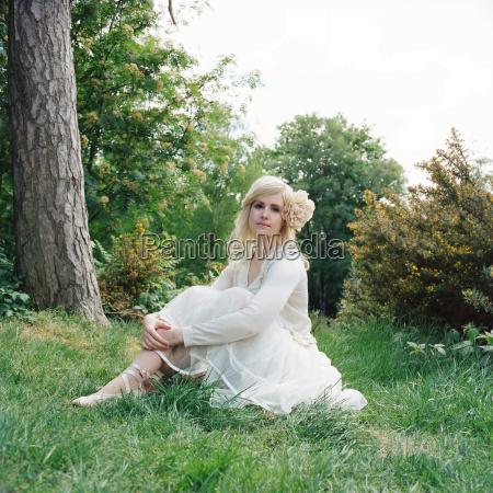 woman wearing white dress sitting on
