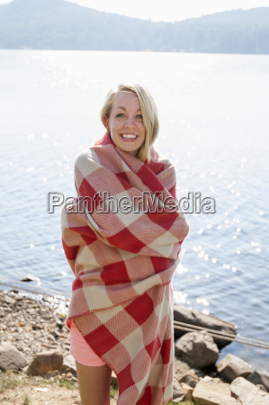young woman wrapped in blanket by