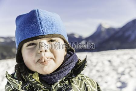 toddler sticking out tongue achenkirch tirol