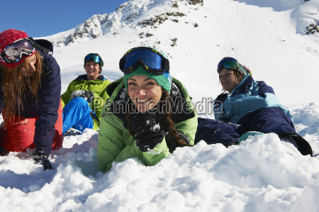 friends lying on snow kuhtai austria