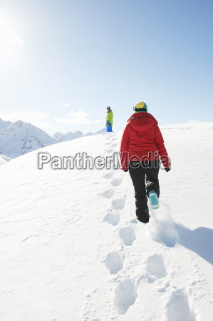 two people walking in snow kuhtai