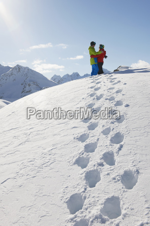 couple hugging in snow kuhtai austria