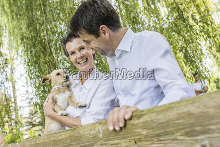 portrait of couple with pet dog