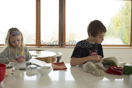 boy and girl sitting at table