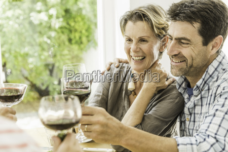 couple toasting with red wine at