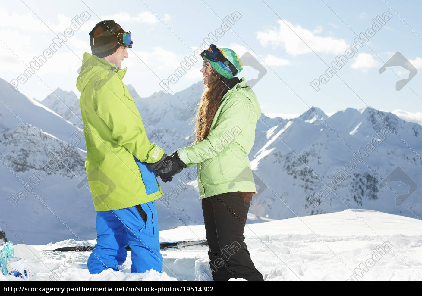 couple, holding, hands, with, mountains, in - 19514302