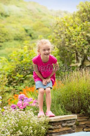 smiling girl playing in garden